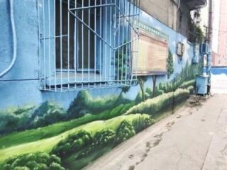 星辉东路社区:彩绘绿植 小区墙面穿新衣